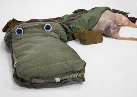 'Odile, 2015-17 Army surplus – sleeping bag, child-sized gas masks, duffel bag, padded skirt, carrying cases; heavy-duty thread, ink, glue, pantyhose, fabric scraps Dimensions variable